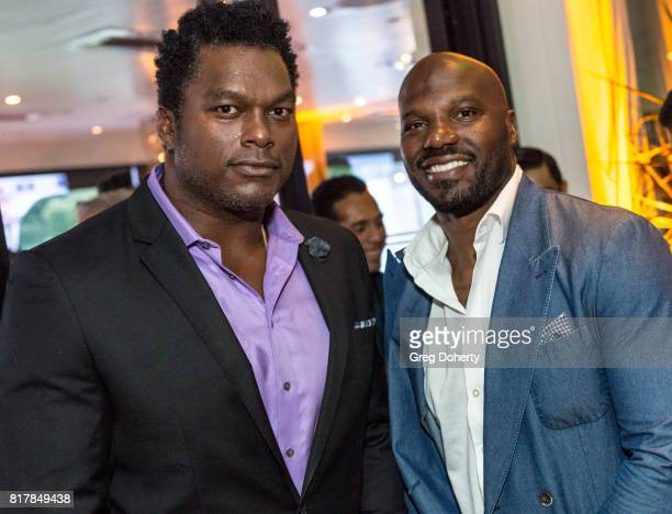 Former NFL PLayer LaVar Arrington D'Quell Jackson attend the Sports Academy Foundation 50 For 50 at Manhattan Country Club on July 13 2017 in...