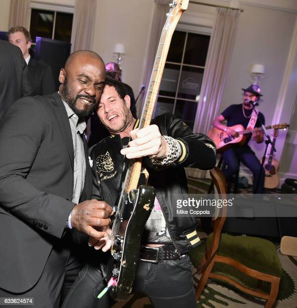 Former NFL player Marshall Faulk and musician Michael Franti perform during the #Culinary Kickoff at Brennan's Restaurant on February 2 2017 in...