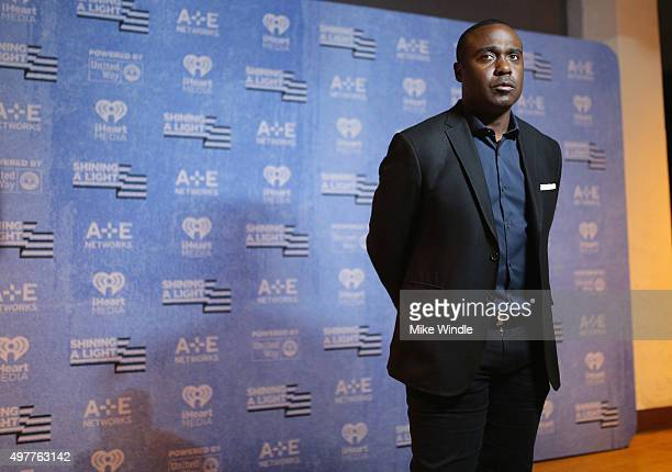 Former NFL player Marshall Faulk attends AE Networks 'Shining A Light' concert at The Shrine Auditorium on November 18 2015 in Los Angeles California