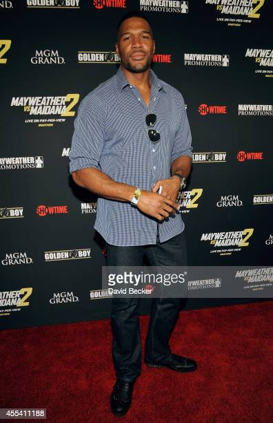 Former NFL player Michael Strahan arrives at Showtime's VIP prefight party for 'Mayhem Mayweather vs Maidana 2' at the MGM Grand Garden Arena on...