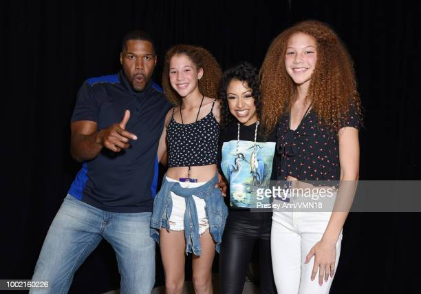 Former NFL player Michael Strahan Sophia Strahan Liza Koshy and Isabella Strahan pose in the Green Room at the Nickelodeon Kids' Choice Sports 2018...