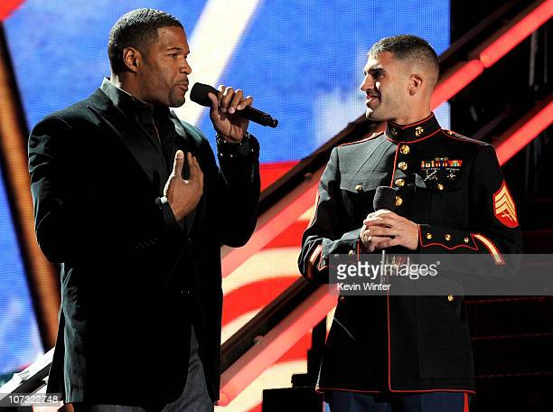 Former NFL player Michael Strahan speaks onstage during 'VH1 Divas Salute the Troops' presented by the USO at the MCAS Miramar on December 3 2010 in...
