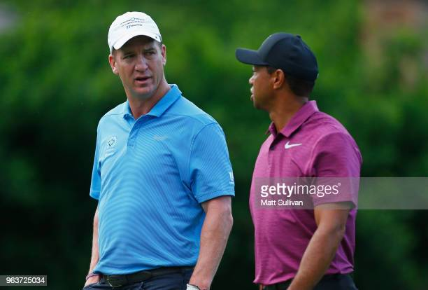 Former NFL player Peyton Manning speaks with Tiger Woods during the ProAm prior to The Memorial Tournament presented by Nationwide at Muirfield...