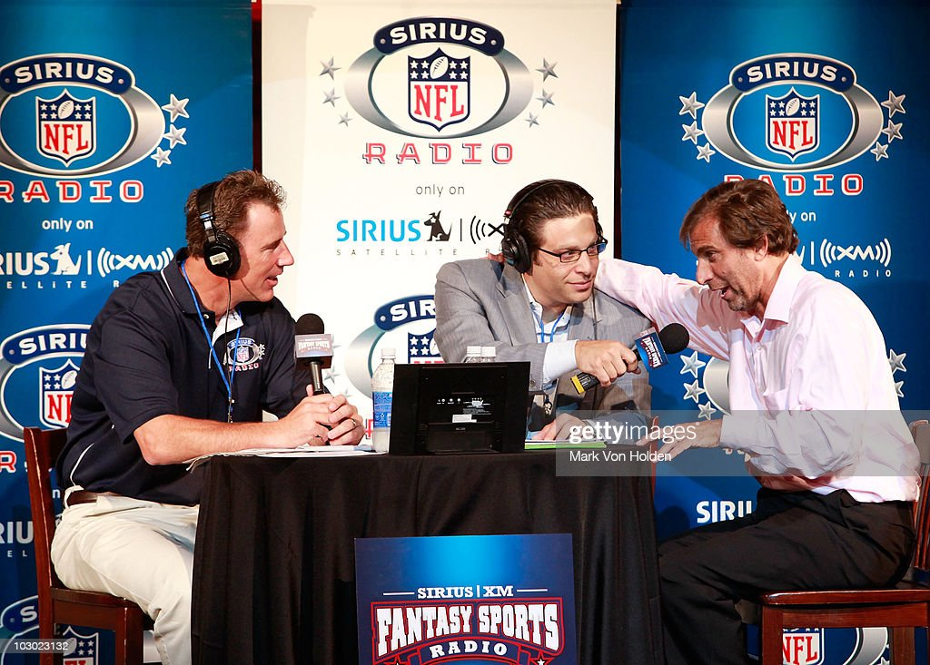 Former NFL player Rich Gannon, Sirius XM radio host Adam Schein, and Sirius XM radio's Chris 'Mad Dog' Russo attend the SIRIUS XM Radio celebrity fantasy football draft at Hard Rock Cafe - Times Square on July 21, 2010 in New York City.