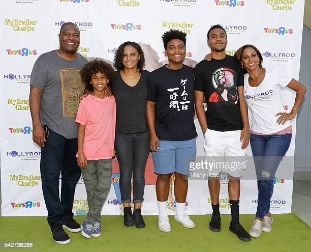Former NFL Player Rodney Peete and Actress Holly Robinson Peete pose with their children at the HollyRod Foundation's 'My Brother Charlie goes to the...