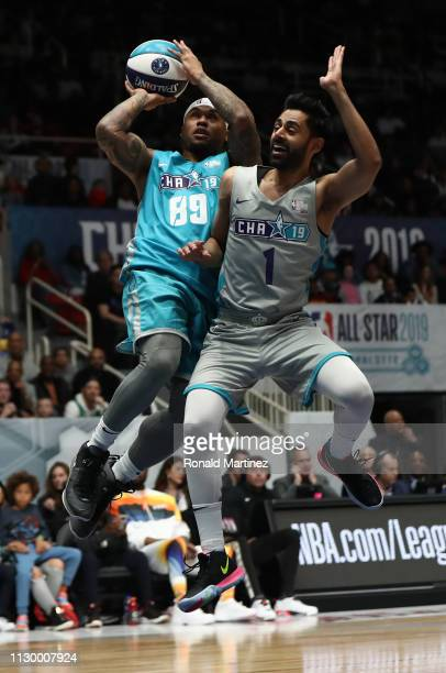 Former NFL player Steve Smith Sr #89 takes a shot against actor Hasan Minhaj during the 2019 NBA AllStar Celebrity Game at Bojangles Coliseum on...