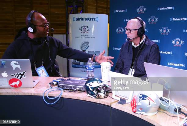 Former NFL player Torry Holt and Rich McKay presdient and CEO of the Atlanta Falcons attend SiriusXM at Super Bowl LII Radio Row at the Mall of...
