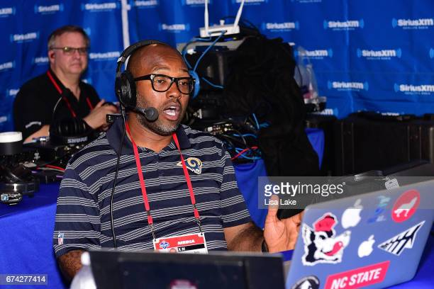 Former NFL player Torry Holt broadcasts live at the SiriusXM Fantasy Sports Radio talkshow during the first round of the 2017 NFL Draft at...