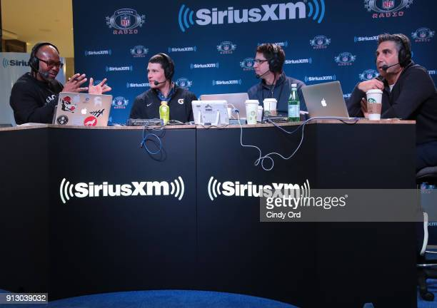 Former NFL player Torry Holt Luke Kuechly of the Carolina Panthers former NFL player Ed McCaffrey and SiriusXM radio host Bob Papa attend SiriusXM at...