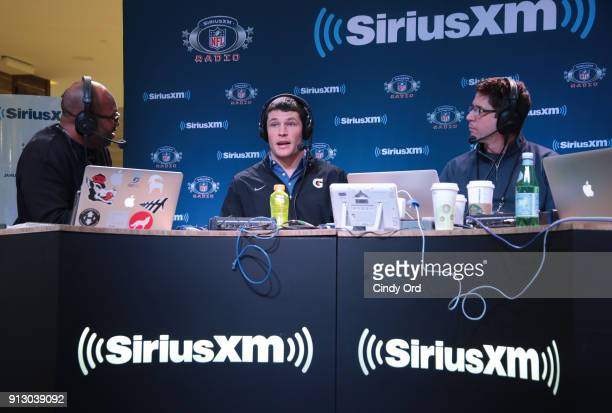 Former NFL player Torry Holt Luke Kuechly of the Carolina Panthers and former NFL player Ed McCaffrey attend SiriusXM at Super Bowl LII Radio Row at...