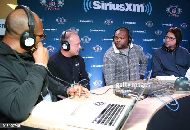 Former NFL player Torry Holt Mike Sisk former NFL player Neil Smith and former NFL player Ed McCaffrey attend SiriusXM at Super Bowl LII Radio Row at...
