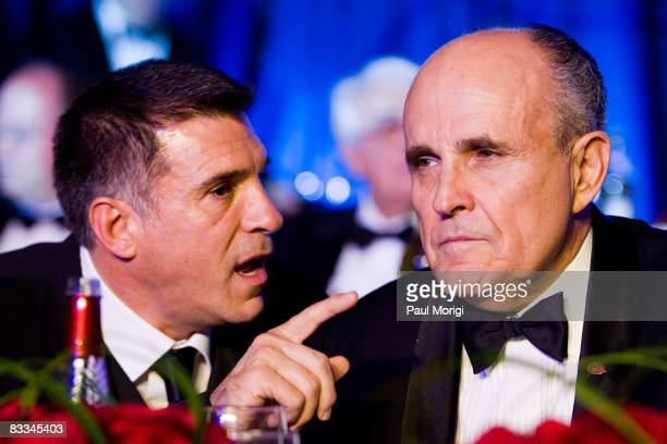 Former NFL player Vince Ferragamo talks with the Honorable Rudy Giulliani at the National Italian American Foundation 33rd Anniversary Awards at the...