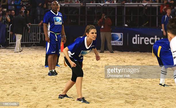 Former NFL player Warren Moon and actress Maria Menounos participate in DIRECTV's Sixth Annual Celebrity Beach Bowl Game at Victory Field on February...