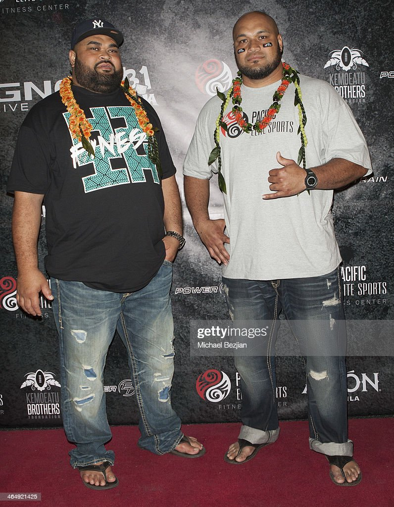 Former NFL players Chris Kemoeatu and Maake Kemoeatu attend the Pacific Elite Sports Fitness Center Grand Opening on January 24, 2014 in Kaneohe, Hawaii.
