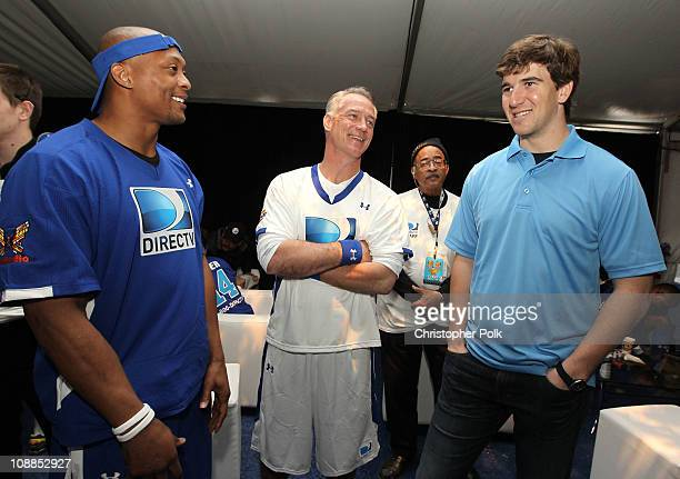 Former NFL players Eddie George and Daryl Johnston and NFL player Eli Manning attend DIRECTV's Fifth Annual Celebrity Beach Bowl at Victory Park on...