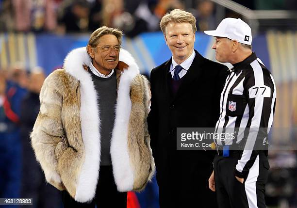 Former NFL players Joe Namath and Phil Simms talks with referee Terry McAulay before the Seattle Seahawks take on the Denver Broncos during Super...