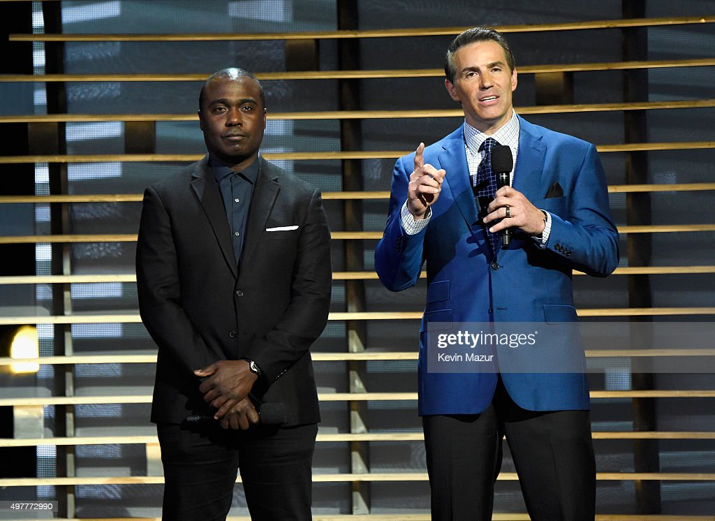Former NFL players Marshall Faulk (L) and Kurt Warner speak onstage at A+E Networks 'Shining A Light' concert at The Shrine Auditorium on November 18, 2015 in Los Angeles, California.