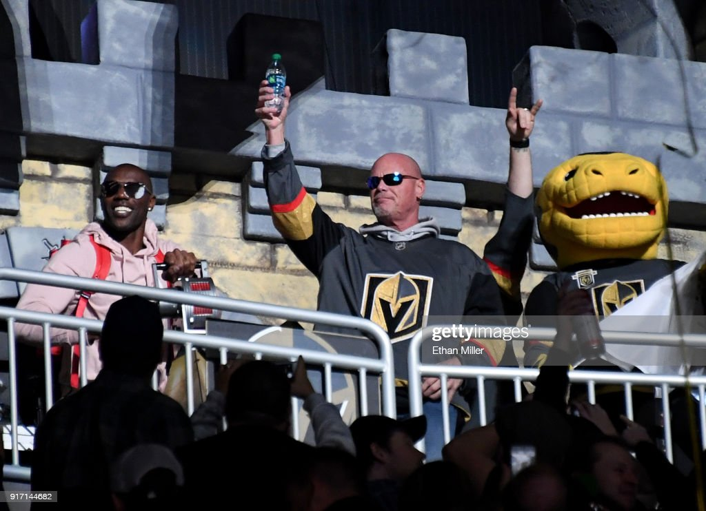 Former NFL players Terrell Owens and Jim McMahon join the Vegas Golden Knights mascot Chance the Golden Gila Monster before the Golden Knights' game against the Philadelphia Flyers at T-Mobile Arena on February 11, 2018 in Las Vegas, Nevada. The Flyers won 4-1.