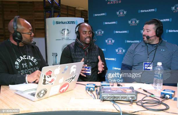 Former NFL players Torry Holt Chris Draft and Joe Andruzzi attend SiriusXM at Super Bowl LII Radio Row at the Mall of America on February 1 2018 in...