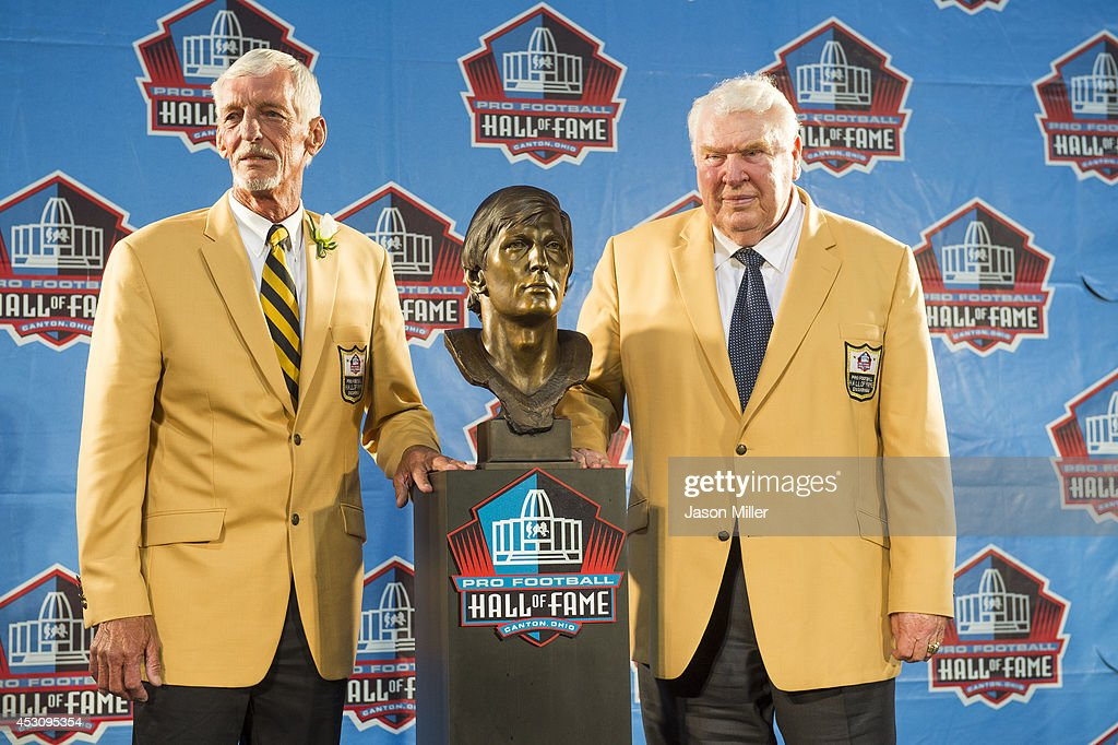 Former NFL punter Ray Guy, left, poses with his bust and former coach John Madden, right, during the NFL Class of 2014 Pro Football Hall of Fame Enshrinement Ceremony at Fawcett Stadium on August 2, 2014 in Canton, Ohio.