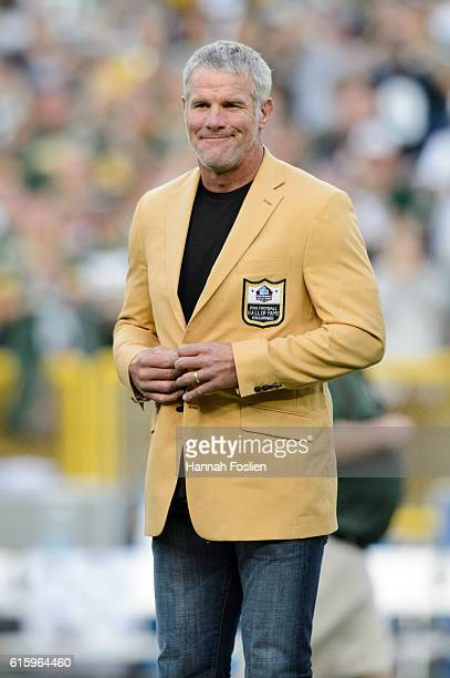 Former NFL quarterback Brett Farve looks on as he is inducted into the Ring of Honor during a halftime ceremony during the game between the Green Bay...