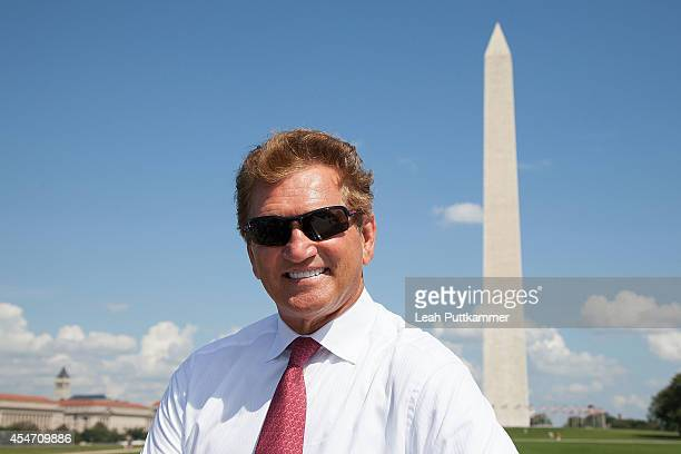 """Former NFL quarterback Joe Theismann enjoys a D.C. Bus tour during the """"Ride of Fame"""" Induction Ceremony on September 5, 2014 in Washington, D.C."""