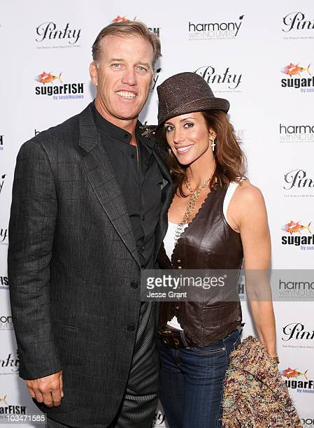 Former NFL quarterback John Elway and actress Paige Green attend the SugarFish by Sushi Nozawa grand opening party on June 9, 2008 at SugarFish In...