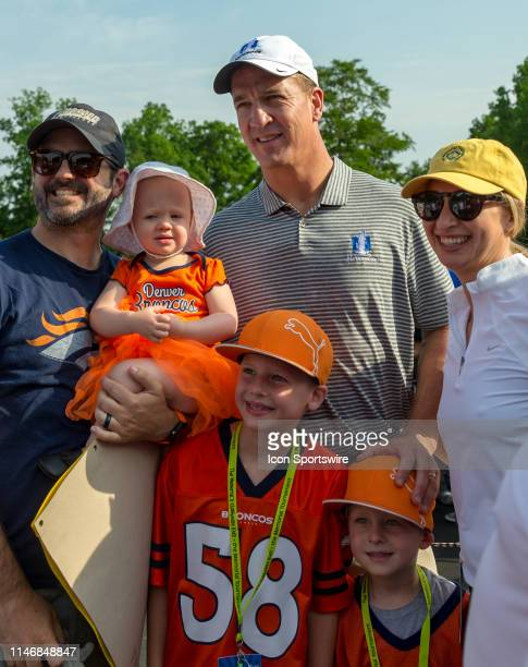 Former NFL quarterback Peyton Manning poses for a photo with fans during the ProAm of the Memorial Tournament presented by Nationwide at Muirfield...