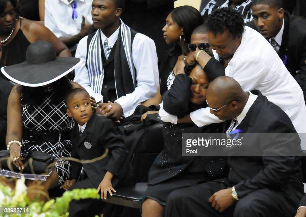Former NFL quarterback Steve McNair's mother Lucille McNair is consoled at the end of a funeral service for her son on July 11 2009 in Hattiesburg...