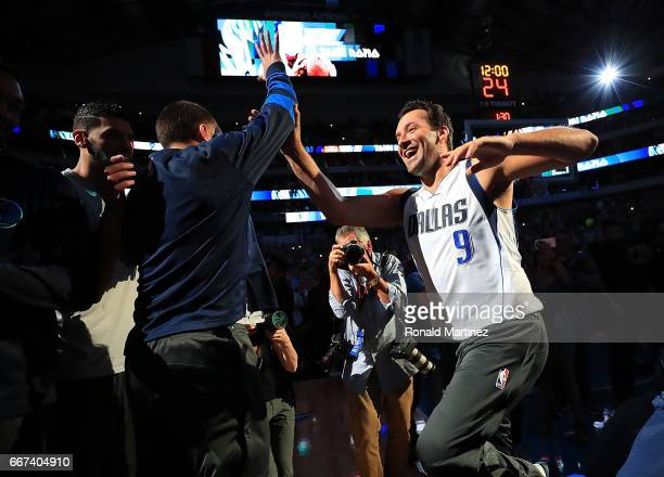 Former NFL quarterback Tony Romo of the Dallas Cowboys is introduced with the Dallas Mavericks before a game against the Denver Nuggets at American...