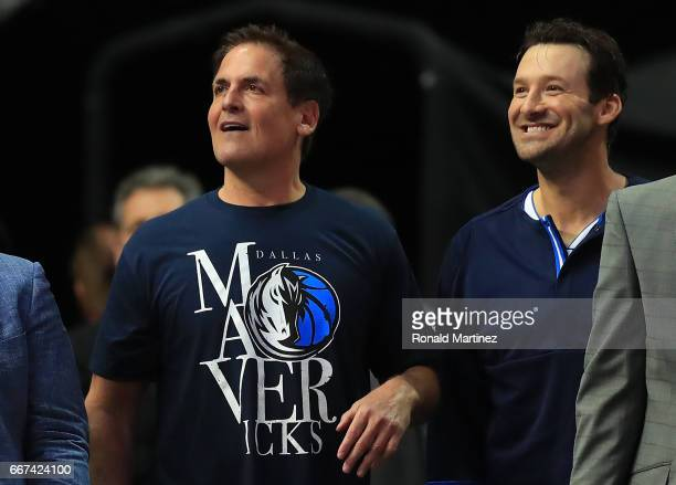 Former NFL quarterback Tony Romo of the Dallas Cowboys sits with Mark Cuban owner of the Dallas Mavericks during a game against the Denver Nuggets at...