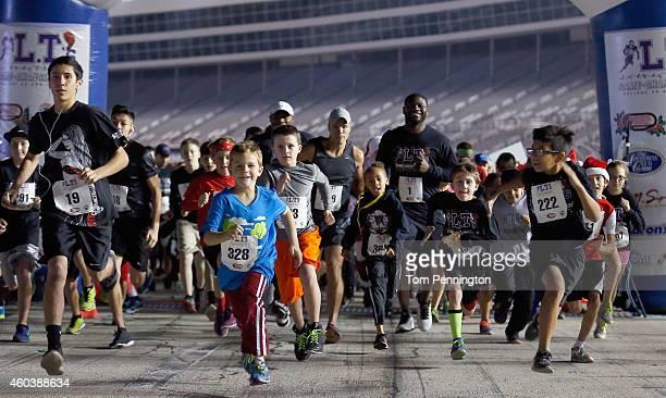 Former NFL running back LaDainian Tomlinson leads the start of LT's GameChanging 5k Run at Texas Motor Speedway on December 12 2014 in Fort Worth...