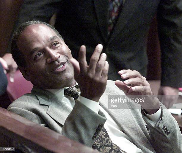 Former NFL star OJ Simpson speaks during the jury selection in his road rage trial October 11 2001 in Miami FL US Federal agents searched Simpson's...