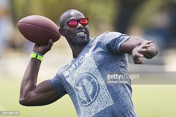 Former NFL star Terrell Owens throws a gridiron ball during a Hawthorn Hawks AFL media opportunity at Gosch's Paddock on January 30 2015 in Melbourne...