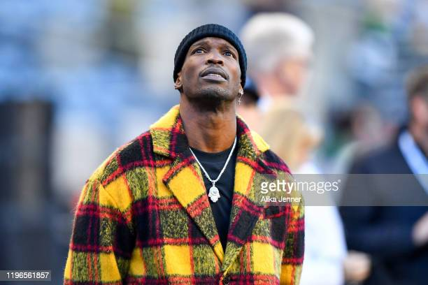 Former NFL wide receiver Chad Johnson looks at the scoreboard before the game between the Seattle Seahawks and the San Francisco 49ers at CenturyLink...