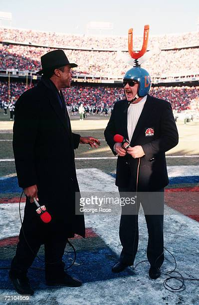 Former NFL wide receiverturned NBC sportscaster Ahmad Rashad and announcer Paul McGuire clown around on the sideline of a 1988 Denver Colorado...