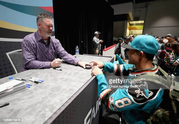 Former NHL and San Jose Sharks player Owen Nolan signs an autograph at the 2019 NHL AllStar Fan Fair at the San Jose McEnery Convention Center on...