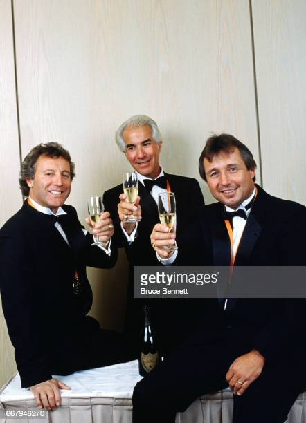 Former NHL goalie Tony Esposito owner of the Philadelphia Flyers Ed Snider and former defenseman Brad Park have a toast during the 1988 NHL awards...