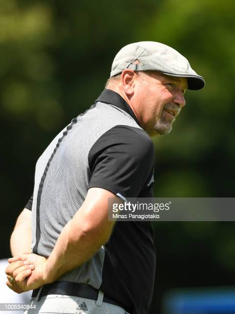 Former NHL hockey player Wendel Clark looks on after hitting a tee shot from the seventh during the practice rounds at the RBC Canadian Open at Glen...
