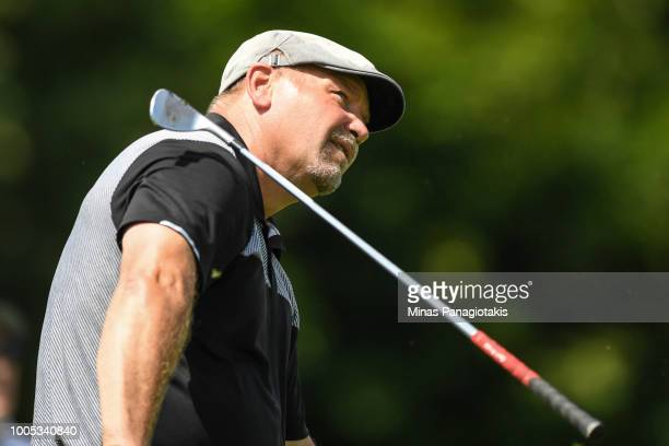 Former NHL hockey player Wendel Clark loses his iron as he tries to hit a tee shot from the seventh during the practice rounds at the RBC Canadian...
