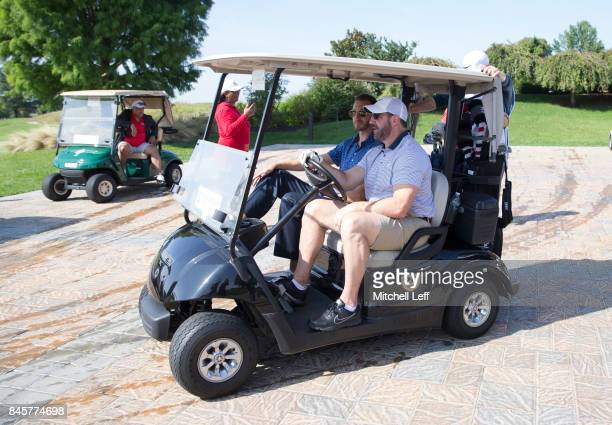Former NHL John LeClair drives his golf cart during the Julius Erving Golf Classic at The ACE Club on September 11 2017 in Lafayette Hill Pennsylvania