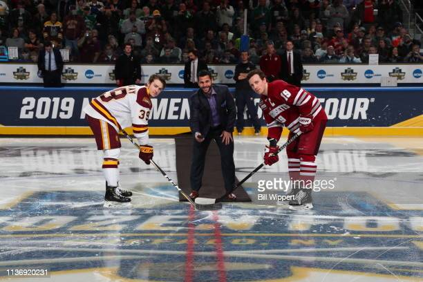 Former NHL player Brian Gionta drops the puck for a ceremonial face off between Parker Mackay of the Minnesota-Duluth Bulldogs and Niko Hildenbrand...