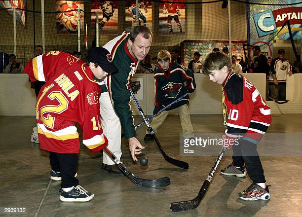 """Former NHL player Brian Mullen drops the ball for the face-off during the """"Hockey is for Everyone"""" street hockey clinic at FANtasy on February 6,..."""