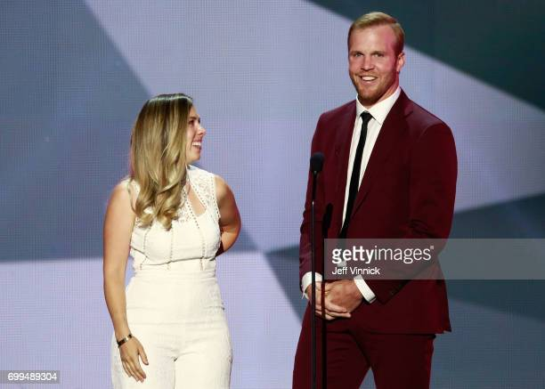 Former NHL player Bryan Bickell and wife Amanda share a laugh onstage during the 2017 NHL Awards Expansion Draft at TMobile Arena on June 21 2017 in...