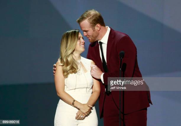 Former NHL player Bryan Bickell hugs wife Amanda onstage during the 2017 NHL Awards Expansion Draft at TMobile Arena on June 21 2017 in Las Vegas...