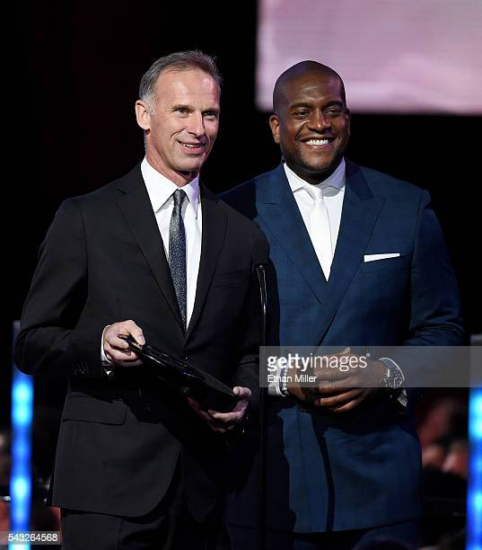Former NHL player Dominik Hasek and NHL Network host Kevin Weekes present the Vezina Trophy during the 2016 NHL Awards at The Joint inside the Hard...