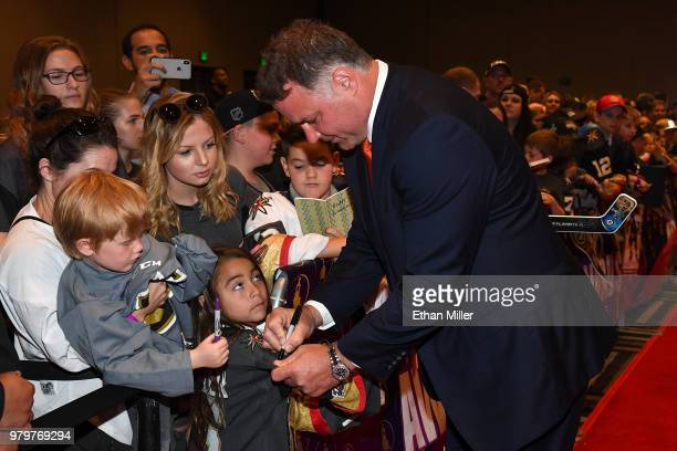 Former NHL player Eric Lindros signs autographs for fans as he arrives at the 2018 NHL Awards presented by Hulu at the Hard Rock Hotel Casino on June...