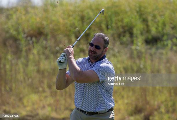 Former NHL player John LeClair attempts a shot during the Julius Erving Golf Classic at The ACE Club on September 11 2017 in Lafayette Hill...