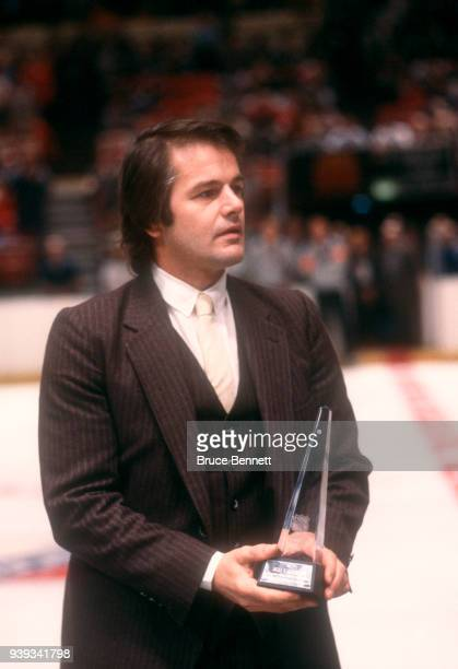 Former NHL player Rod Gilbert receives an award before a New York Rangers game circa December 1982 at the Madison Square Garden in New York New York