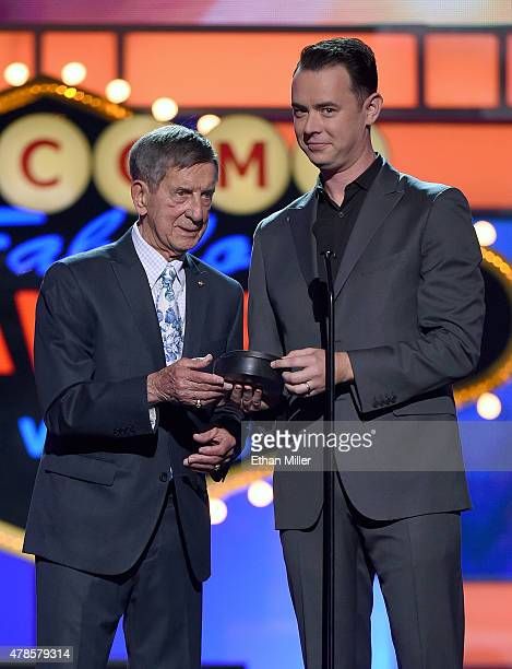 Former NHL player Ted Lindsay and actor Colin Hanks present the Ted Lindsay Award during the 2015 NHL Awards at MGM Grand Garden Arena on June 24...